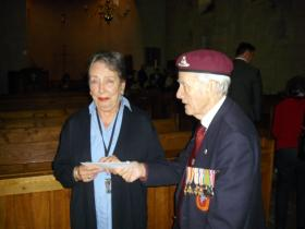 An Arnhem Veteran makes a donation to the church.