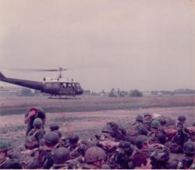 Members of 16 Lincoln Coy waiting for a lift on a Huey for a heli jump, 1970s