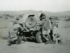 Soldiers from 15th (Kings) Parachute Battalion attempt to recover a crashed Jeep, India, 1946