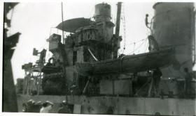 Shell and small arms damage clearly visible on the HMIS Hindustan after the incident, February 1946