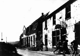 Airborne troops investigate a building