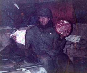 An Argentine soldier with rations from home, Falklands, 1982