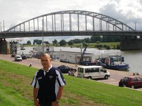 Mark Magreehan stands before John Frost Bridge, Arnhem