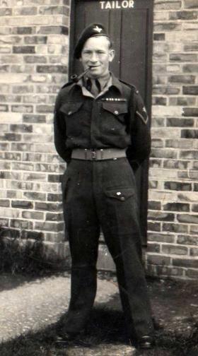 L/Cpl 'Reg' Moore outside the tailor's shop, c1945.