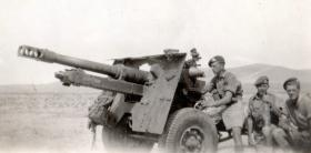 Members of the 211 Airlanding Light Battery RA with a 25 Pounder Artillery gun, Asluge, Palestine, 2 June 1946.