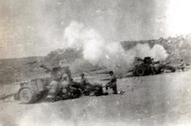 Members of the 211 Airlanding Light Battery RA firing a 25 Pounder Artillery gun, Asluge, Palestine, 6 July 1946.