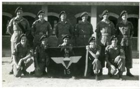 Members of Assault Company, 15th (Kings) Parachute Battalion with the Battalion flag, India, 1946