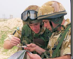Map-check in vicinity of Az Zubayr, note the Para helmets and choc chip camouflage netting, Op Telic III Iraq, 2003-04,