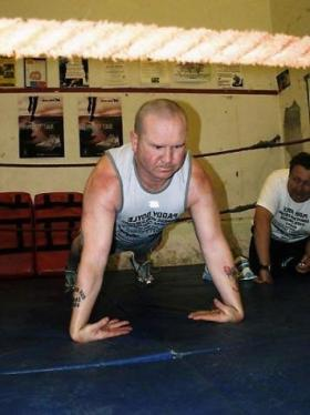 Paddy Doyle breaking record for most back of hands push ups in one hour