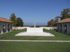 View of Altar of Remembrance with Cross of Sacrifice in background, Bari War Cemetery 2011.