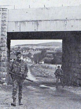 Sgt 'Ted' Barrett and Pte 'Meano' Smith on patrol at the Kilnasagart Bridge, Co Armagh, NI, 1981.