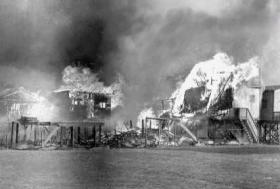Beach houses on fire, date unknown.