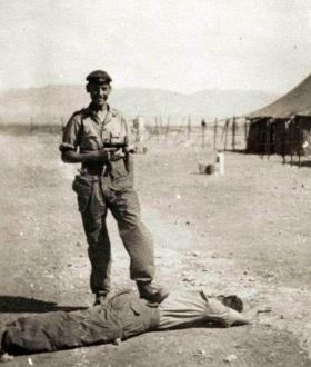 Gdsm John Anderson fooling about before an operation against EOKA, Cyprus c1956.