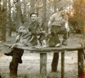 Two members of Scout Platoon, 13 Para Bn, with Para dogs, c1944-5.