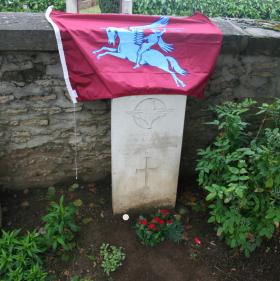The grave of my uncle, Private Edward Blackburn after my wife and daughter planted a small rose bush, June 2012.