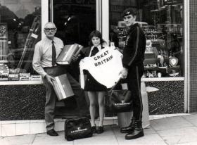 Capt 'Bob' Midwood presents Albert Owens with some kit, c1972.
