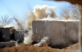 Bomb disposal specialists carry out an controlled explosion on a IED, Char Coucha, Afghanistan, 2011