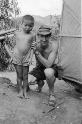 George Parry, and local child, 2 PARA, Borneo, 1965