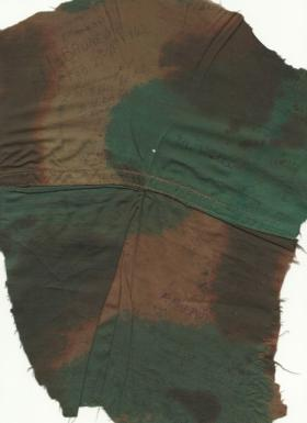 A piece of Sgt Lutener's parachute used in Operation Biting and signed by his colleagues.