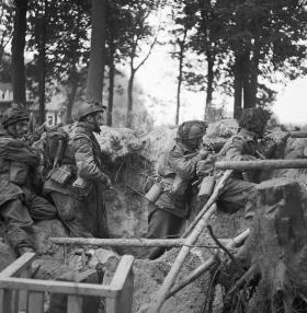 Men of No 3 Platoon, R Company, 1st Parachute Battalion armed with Bren gun and No. 4 rifles defend a large shell hole.
