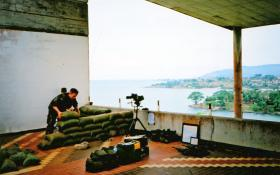 Cpl 'Buzz' Burrows, Mortar Platoon, 2 PARA, constructing an observation post in D Coy's HQ Building, Sierra Leone, May 2000.