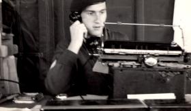 Sgt Paddy Bruen on the phone in the office