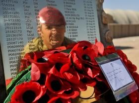 Capt Andy Whitehead reflected in the Camp Bastion memorial plaque, Afghanistan, November 2010