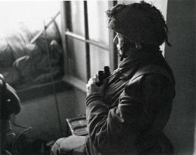 Capt F Vere Hodge, MC, observing naval shelling, June 1944.
