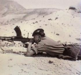 Pte Charlesworth on range practice with a Bren Gun in Cyprus, 1956.