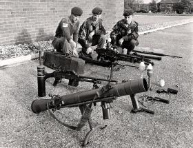 Small Arms laid out for a demonstration, a Carl Gustav is in the foreground, circa 1970s.
