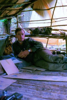 Lt 'Chris' Johnson in his camp in the jungle near the border, Borneo, 1965.