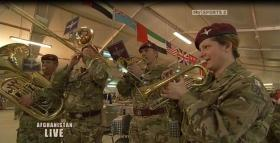 The Parachute Regiment Band perform for a live tv recording in Camp Bastion Christmas 2010