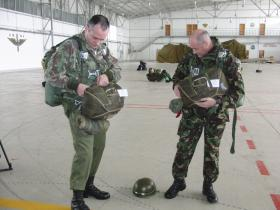 Harvey Grenville (left) and Paul Cavanagh rig up for a jump with Portuguese Airborne Forces, Tancos, 2009.