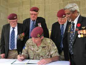 Major General Bashall CBE at Kranji Ceremony, with veterans Mick Murtagh, Les Simcock and George Averre.