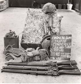 CLE containing various weaponry and ammunition, including Vickers Gun and tripod.