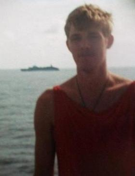 Pte Dave Brown on the MV Norland sailing South 1982- Canberra in background