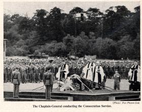 The Chaplain-General conducting the Consecration Service of the Colours, Aldershot 19 July 1950.