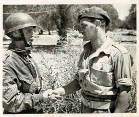 Sgt Instructor Alf Cook GM of the Army Physical Training Corps talking to a paratrooper c1943