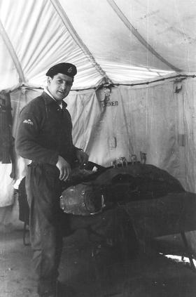 Cpl Rick Rossi packing his weapon container in our tent at Waynes Keep, Cyprus, 1959