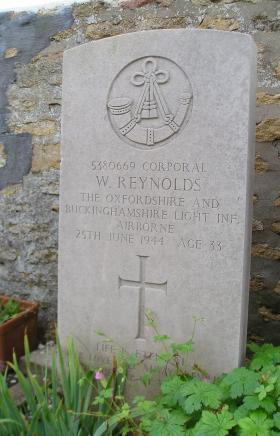 Headstone of Cpl W Reynolds, Herouvillette Cemetery, October 2010.