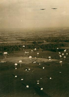 Parachutists descend to land on a DZ at Tatton Park, after exiting Whitley bombers