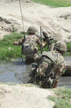 Soldiers of 3 PARA crossing a ditch, Kandahar, Afghanistan, 2008