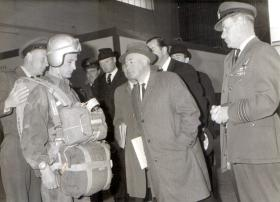 CSM Bing displays tactical freefall kit to Labour Minister of Defence at No 1 PTS RAF Brize Norton, mid 1960s.