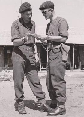 Sergeant Major Charles Buckmaster talking to John Harwood, Sarafand, Palestine, in February 1946.