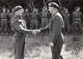 CSM Miller receiving his MM from General Montgomery, 1944.