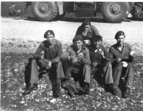3rd King's Own Hussars armoured car crew stop for break, Palestine, c1946-47.