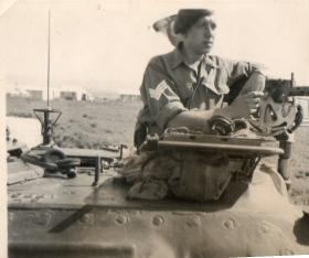 Sgt Denis Chapman looks out from a Staghound at the Bridge of Acorn, Megiddo, Palestine, 1947.