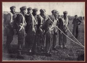 During filming of The Red Beret movie, George Moodie is jumper on far right c1953