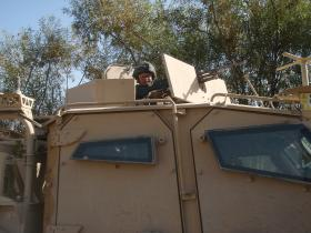 Pte Dan Prior Providing Top Cover from a Husky Vehicle, Afghanistan, 2010