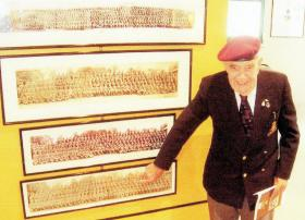 David King pointing at himself on the picture he presented to the Memorial Pegasus Museum, Normandy, 2004.